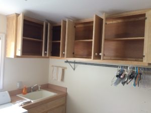 julie laundry room empty small cabinets